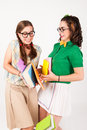 Cute nerdy girls bump into each other studio shot Royalty Free Stock Photo