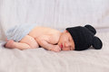 Cute newborn baby in black mouse hat soft image of sleeping on grey background focus on face hand and leg Stock Photography