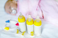 Cute newborn baby girl with nursing bottles and pacifier Royalty Free Stock Photo