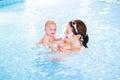 Cute newborn baby having fun in swimming pool Royalty Free Stock Photo