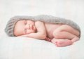 Cute newborn baby sleeping on fluffy lace scarf Stock Photography