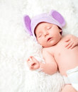 Cute newborn baby sleeps in a hat with ears mouse Royalty Free Stock Photos