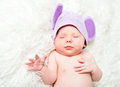 Cute newborn baby sleeps in a hat with ears mouse Royalty Free Stock Photo