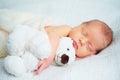 Cute newborn baby sleeps with toy teddy bear Royalty Free Stock Photo