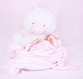 Cute newborn girl sweet lying down in pink bedroom near big white fluffy teddy bear happy childhood love concept Royalty Free Stock Image