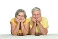 Cute old couple drinking tea is lying at carpet and Stock Photos