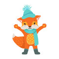 Cute orange fox character wearing in a light blue knitted hat and scarf, funny cartoon forest animal posing with hands Royalty Free Stock Photo