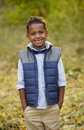 Cute outdoor portrait of a smiling African American young boy Royalty Free Stock Photo