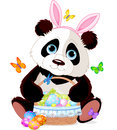 Cute panda with easter basket holding full of eggs Royalty Free Stock Image