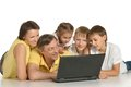 Cute parents and kids with a laptop Stock Photography