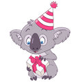 Cute party cartoon koala and happy new year in a hat holding a gift box Stock Photo
