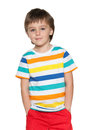 Cute pensive little boy in striped shirt a portrait of a on the white background Stock Images