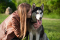 The cute photo of a girl huging her dog husky Royalty Free Stock Image