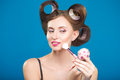 Cute pin up girl applying blusher in curlers Royalty Free Stock Photos