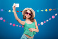 Cute playful little girl taking selfie with mobile phone Royalty Free Stock Photo