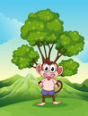 A cute playful monkey at the hilltop standing under the tree illustration of Stock Photography