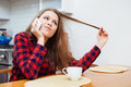 Cute playful woman talking on mobile phone and drinking coffee Royalty Free Stock Photo
