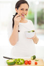 Cute pregnant woman eating salad at home Stock Images