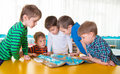 Cute preschoolers plaing game on table geography Stock Photo