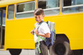 Cute pupil walking to the school bus outside elementary Royalty Free Stock Photos