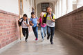 Cute pupils running down the hall Royalty Free Stock Photo