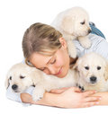 Cute puppies and young girl hugging Stock Image