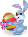 Cute rabbit cartoon holding easter egg illustration of Stock Photo