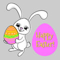 Cute rabbit with egg greeting card for easter Stock Photo