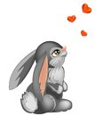Cute rabbit looking at three little hearts Royalty Free Stock Photo