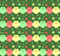 Cute red, green and yellow owls in a row with flowers in the bac