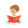 Cute redhead boy wearing glasses reading a book, kid enjoying reading, colorful character vector Illustration
