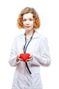 Cute redhead doctor in lab coat with heart isolated on white background Stock Photos