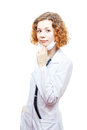 Cute redhead doctor in lab coat with mask isolated on white background Royalty Free Stock Photos