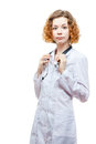 Cute redhead doctor in lab coat with stethoscope isolated on white background Stock Photos