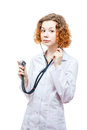 Cute redhead doctor in lab coat with stethoscope isolated on white background Royalty Free Stock Photography