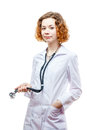 Cute redhead doctor in lab coat with stethoscope isolated on white background Royalty Free Stock Images