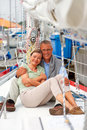 Cute retired couple sitting together on a sailboat Royalty Free Stock Image