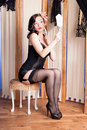 Cute retro model in black lingerie in boudoir Royalty Free Stock Photo