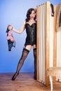 Cute retro model teasing in black lingerie Stock Photography
