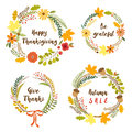 Cute rustic hand drawn wreath with nature elements in traditional autumn colors