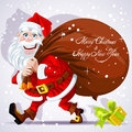 Cute Santa Claus carries a bag of gifts Royalty Free Stock Photo