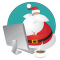 Cute Santa shopping for christmas on his computer Royalty Free Stock Image