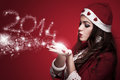 Cute santa woman blowing new year beautiful brunette in the costume snowflakes and make numbers Royalty Free Stock Photo