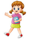 Cute school girl holding a book