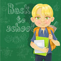 Cute schoolboy with textbooks and notebooks backpack near blackboard Royalty Free Stock Photos