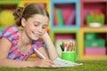 Cute schoolgirl doing homework