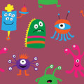 Cute seamless pattern with different monsters on a pink backgrou