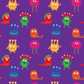 Cute seamless pattern with different monsters on a purple back