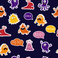 Cute seamless pattern with monsters on a dark background