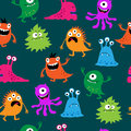 Cute seamless pattern with monsters on a green background